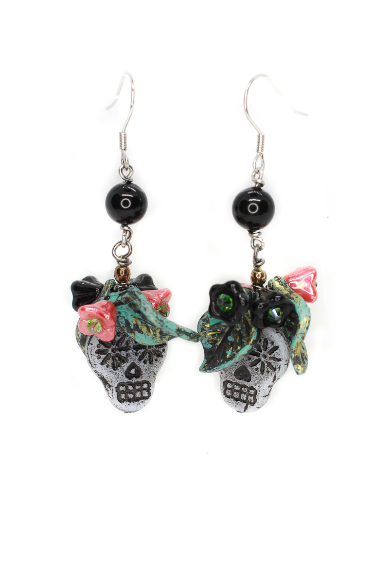 Alluring Day Of The Dead black sugar skull dangle earrings with black and coral flowers #statementearrings #sugarskullearrings #dropearrings #dayofthedeadjewelry