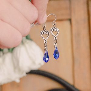 "Elegant sapphire blue crystal heart drop earrings. A seamless choice for a ""something blue"" bridal gift."" #blueearrings #somethingblue #somethingbluegift #crystalearrings #heartdropearrings #crystaldropearrings"