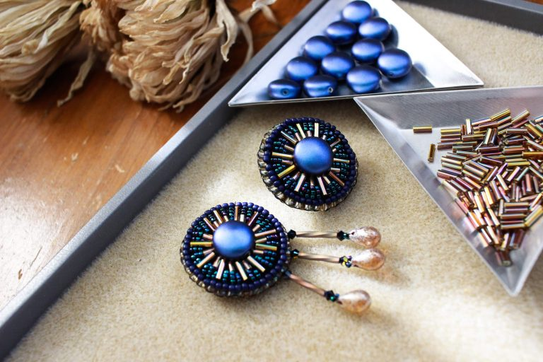 This dazzling set of accessories is embroidered with seed beads and a Swarovski Crystal coin bead. Their colors and design offer great versatility in wearability. #handmadeaccessories #vintageinspired #beadlove #bringbackthebrooch