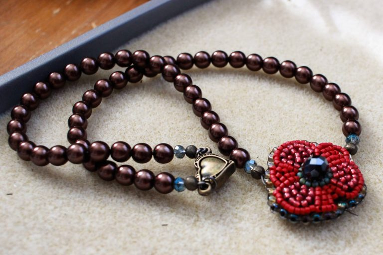 This bead embroidered red rose necklace is charming and bold in color and design. #redrosenecklace #rosenecklace #handmadejewelry #fridainspired #fridakahloinspiredjewelry